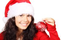 9103 a beautiful young woman with a christmas hat and an ornament or